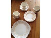 Cream gold tea set/cups saucers