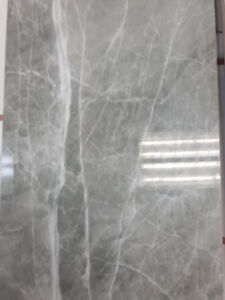 12 x 24 and 24 x 24 porcelain tile for 2.99 a sqft.