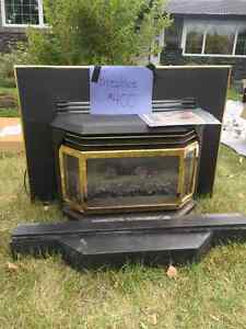 Gold plated gas fireplace. Regency