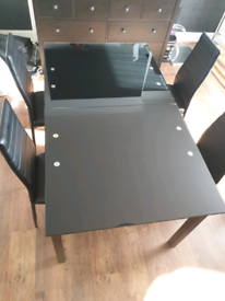 Beautiful Modern Black Glass Extendable Dining Table and Chairs