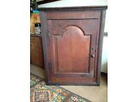 Early Victorian oak corner cupboard