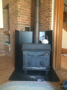 Air tight wood stove and shields,pipes good for cottage