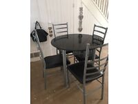 Black 4 seater table and chairs