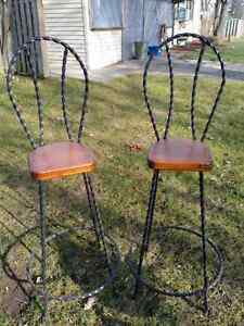Two wrought iron / wood bar stools