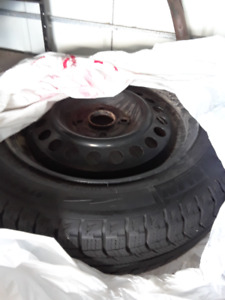 4 Honda snow tire on rim, used only 1 winter