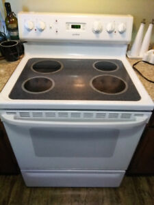 30 inch White stove with glass top.  Good Condition $100