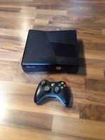 XBox 360 with controller and 3 games.
