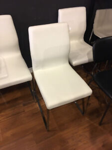 Modern white faux leather dining chairs with chrome base