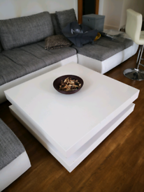 Huge white coffee table with shelf