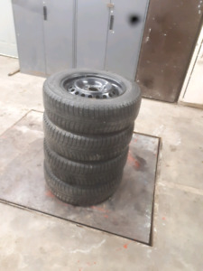 4 Michelin X-ICE tires on genuine ford black rims