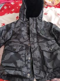 Boys black dinosaur camo jacket size 12 to 18 months