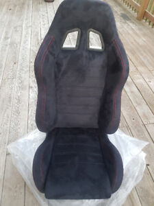 Swade car  bucket seats with red stitching