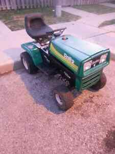 Riding lawn mower.