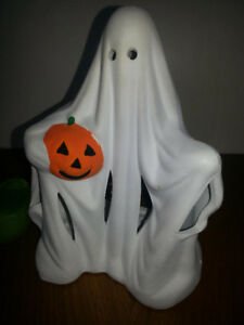 Vintage ceramic ghost holding a pumpkin for Halloween Decor