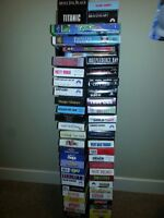50 Assorted VHS Movies & (DVD/VHS Stand)