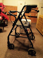 Walker with wheels and brakes