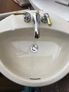 Two Bathroom Sinks with Taps