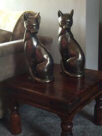 2 large cat statues