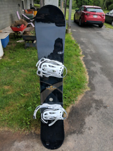 159cm K2 Snowboard and helmet