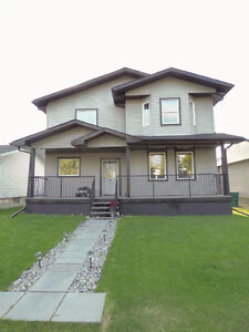 GORGEOUS NEWER HOME WITH 2 KITCHENS!