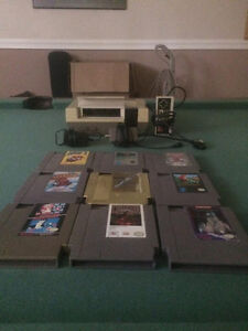 $175 OBO Good working original nes with game lot.