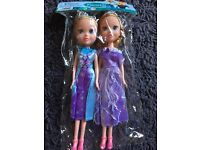 Two toddler Elsa and Anna Frozen dolly