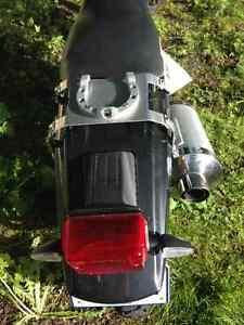 Suzuki DR650 custom exhaust.