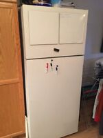 Stove McClary And Inglis refrigerator both for 200$ or 125$ each