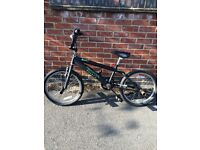 BLACK BMX BIKE (WITH GREEN MONSTER ENERGY STICKERS)