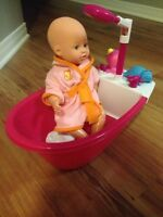Baby doll with bathtub and a baby doll stroller