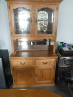 Oak china cabinet and dining room table