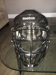 all black reebok hockey helmet with under armour lacrosse cage