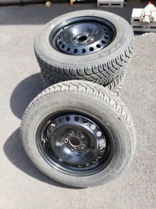 Four 215/60R16 tires and rims