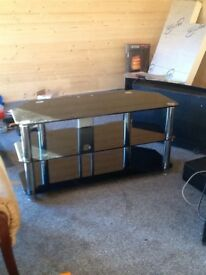 SMOKED GLASS TV UNIT BLACK AND CROME GOOD CONDITION NO CIPS