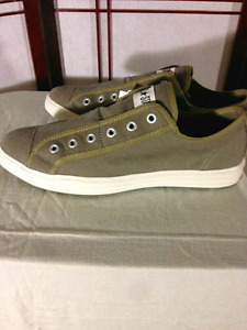 Men's size 12 slip on green canvas Converse shoes.