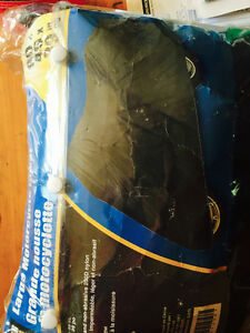 New in package Large motorcycle cover , price firm