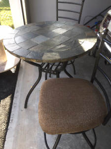 bistro table and 2 matching swivel chairs
