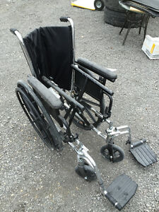 Wheelchair by Invacare with padded seat cushion