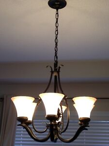 Gorgeous bronze chandelier with pine cone detail