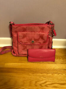 Pink Coach crossbody purse with wallet