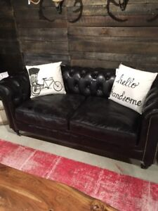 Black leather tufted chesterfield sofa