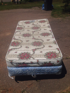 Twin mattress, box spring, and wheeled frame