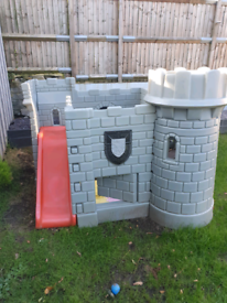 Children play castle with slide