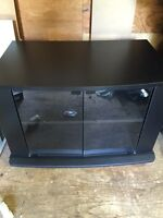 TV STAND WITH GLASS IN GREAT CONDITION