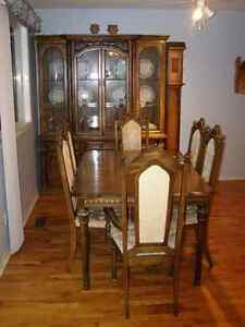 table(2 extensions) and hutch-6 chairs-like new!