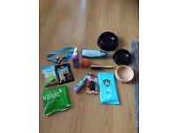 Unused dog and puppy accessories, bowl, toys, brush etc