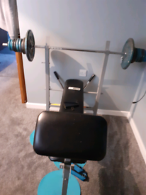 Pro fitness weight bench with metal weight plates 50kg and bar 10kg.