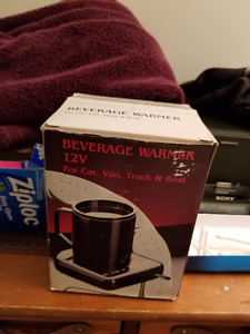 DRINK WARMER (CAR ON THE GO) (NEW NEVER USED)