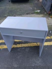 34. Grey desk
