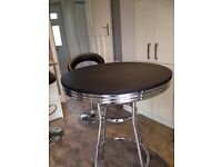 Black and silver bar tables
